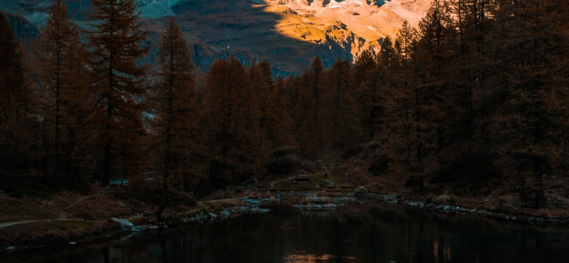 Image of mountain, lit at the top