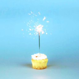 Cupcake with candle on blue light background