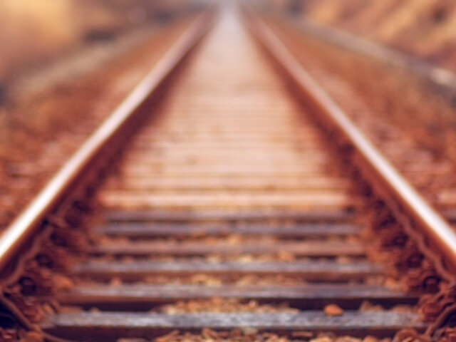 A railway track tapers off into the distance.