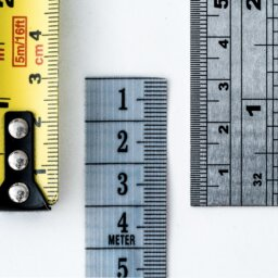 Close ups of segments of parallel measuring tapes