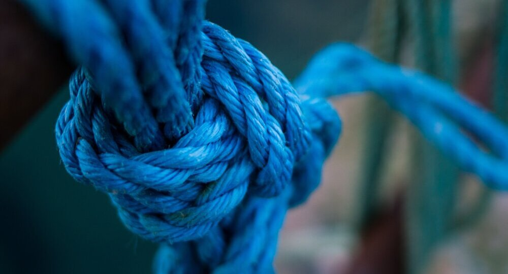 A blue knotted rope