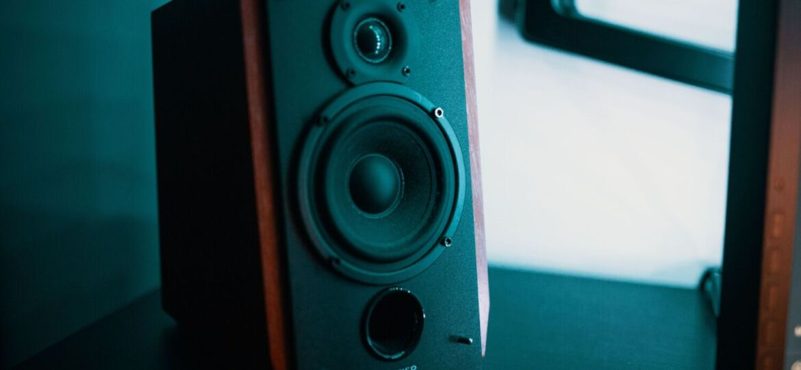 An audio speaker in dramatic blue-tinged lighting